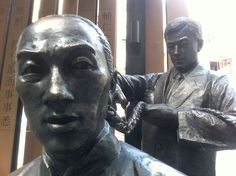 """Cutting off the Queue"" sculpture at Pak Tsz Lane Park, Hong Kong"