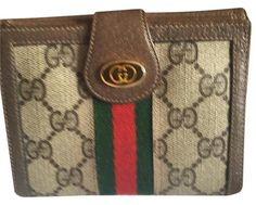 74b66d30cbc Gucci Wallet GG Monogram. Free shipping and guaranteed authenticity on Gucci  Wallet GG Monogram at