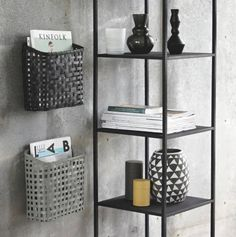 These stunning bamboo baskets matched the cool grey colour scheme of my living room perfectly! I had to have them! The bottom one is often home to a colouring book or two, but the top two belong to my husband and I; saving me from tidying magazines and flyers that are often left lying around!