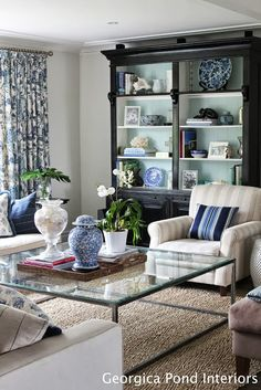 blue back in black cabinet 20 Blue and White Family/Living Rooms- The Glam Pad
