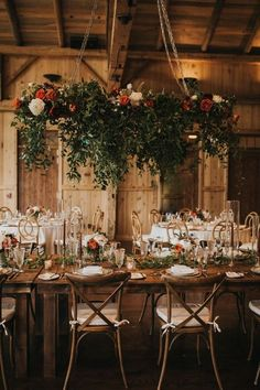 This lush floral installation stole the show at this rustic Colorado reception | Image by Jill Houser Photography