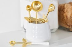 A blooming set of gold-tone measuring spoons — there's a really great joke to be made here about measuring out your flour with a flower, but I just don't know it. 31 Housewarming Gifts That Only Look Expensive Great Jokes, Butter Toffee, Inexpensive Furniture, Furniture Ideas, Donate To Charity, Champagne Flutes, Glass Candle Holders, Ceramic Planters, Paint Cans
