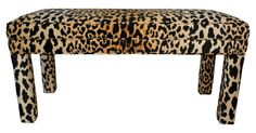 Parsons-style bench upholstered in a soft velvet-like leopard print fabric.