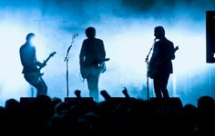 a rock band on stage with guitars