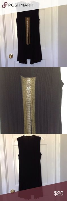 Cute dress/ tunic with chain accent Pin tucks down front along with  gorgeous chain detail. Ties at side to tie in back. Lots of stretch. Wore once Dresses