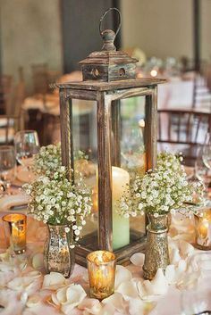vintage lantern wedding centerpieces with candles and baby's breath