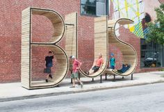 Baltimore Gets a Giant Bus Stop Shaped Like the Word 'Bus' - CityLab