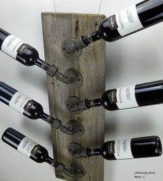 Industrial pipe wine rack, upcycling with naturally greyed wood. ilTubo…