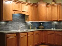 Kitchen Color Ideas With Maple Cabinets maple kitchen cabinets with dark wood floors, dark countertops