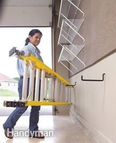 Use large hooks to hang a ladder on the wall. (Remember to drill into a stud!):