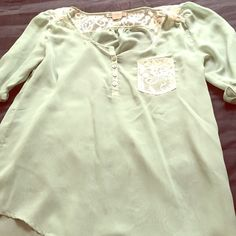 Green top Chiffon material. Green with some cream lace. 3/4 sleeve. Medium size but it fits me and I usually wear a xs/s. It's a loose top though Tops Blouses