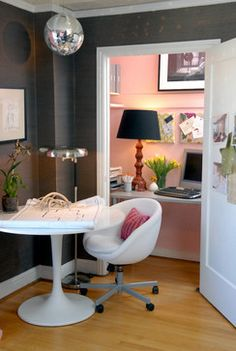 Turn a closet into a pretty office nook with a shelf, lamp and decorated bulletin boards.