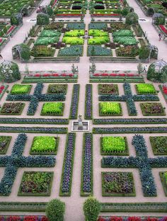 The Chateau de Villandry is justly famous for its gardens. From the roof of the Chateau, the layout of the formal garden - which features an unusual mixture of flowers and vegetables can be fully appreciated. The gardens were restored after Joachim Carvallo purchased the chateau in 1906.