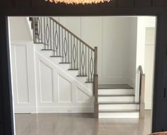 Love the railing, hardwood color, moulding, and the dark moulding in the fore picture.