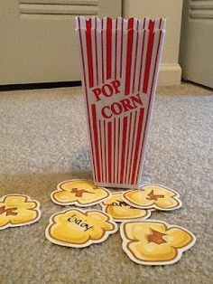 This is an activity for speech therapy however, I think it would be cool to use for literacy or numeracy---matching upper and lowercase letters, dots and numbers, etc.  Popcorn pieces could easily be made out of yellow construction paper or cardstock and those platic popcorn containers can be found at Dollar Tree-2 for $1!!!!