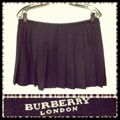 Burberry 675.00 pleated black wool mini skirt sz. M/S; RR Price: 225.00    http://resaleriches.mybisi.com/product/burberrypleatedminiskirt