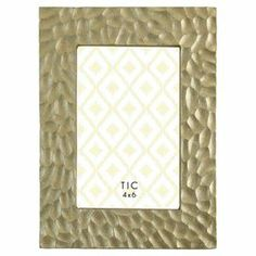 """Highlight your favorite family photos in eye-catching style with this chic picture frame, featuring a textural motif for visual interest.  Product: Picture frameConstruction Material: AluminumColor: GoldFeatures:  Textural motifSmall holds one 4"""" x 6"""" photoLarge holds 5"""" x 7"""" photo Dimensions: Small: 8.5"""" H x 7"""" W x 1"""" D Large: 9.5"""" H x 7.5"""" W x 1"""" D"""