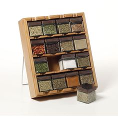 Give your kitchen some zest with this stylish cube spice rack. Included are 16 glass containers that are easy to clean. This set also includes 16 premium spices, including basil, chives, oregano, sea salt, season salt, parsley, and more.