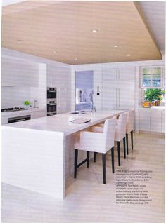 Very sleek, modern kitchen, extremely stylish and functional. Love this.