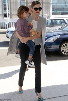 Travelling light: Miranda Kerr looked her elegant self as she and her three-year-old son Flynn jetted out of Sydney on Wednesday with a jaw-...