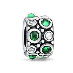 Bling Jewelry 925 Silver Caviar Green CZ Bead Fits Pandora. Simulated Emerald May Birthstone. CZ: 1.6 mm L x 1.6 mm W. Material: 925 Sterling Silver, Cubic Zirconia. Measure: 10 mm L x 8 mm W, 4 mm Bead Core. Weight: 2.2 Grams, Compatible with 3mm and smaller Chains.