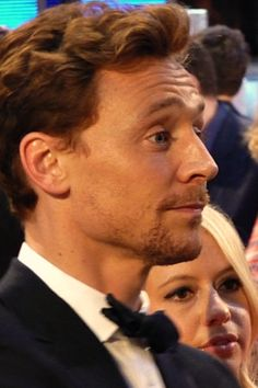 Hiddles, he looks like he is try hard to pay attention and not laugh