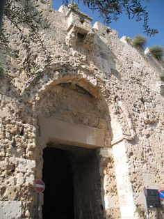 Bab El Sahyoon باب الصهيون = Zion Gate at Armenian Convent - the Old City of Jerusalem, Israel.   Zion gate is riddled with bullet holes from the War of 1948.
