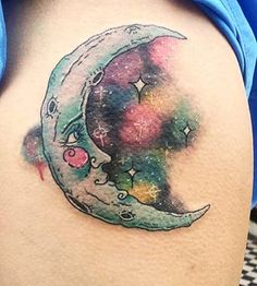 This colourful cosmic ink. | 19 Tattoos Of The Moon That Are Seriously Stunning