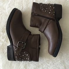 Brown Studded Ankle Boots In amazing condition! Rubber sole, synthetic, and man made material. Heel measures approx: 1.25 inches and shaft  measures approx: 5.25 inches! Boot opening is approx 11 inches. Features functional zipper and studs and buckles for added style. No trades please. 111915uedb Skechers Shoes Ankle Boots & Booties