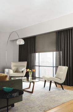 Sheer draperies and complementary automated shades create a beautiful window treatment design. Source: Room and Board