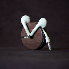 Wood Earbud Holder  Never deal with tangled headphones again with this stylish wood earbud holder.
