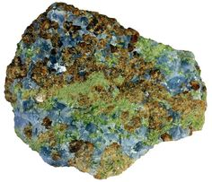 Skarn is a metamorphic rock type. It forms when magmatic liquids react with carbonate rocks (limestone, marble). This skarn is composed of calcite (blue), pyroxene augite (green), and garnet grossular (orange). Width of view 6 cm. Country: Italy.