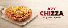 Eating KFC's new 'Chizza' pizza: A journey into regret     - CNET  Enlarge Image                                                      KFC                                                  KFC maker of fried chicken is once again trying its hand at pizza.  Called the Chizza this unholy love child of fried chicken and pizza replaces the pizza dough with a big fried chicken fillet. Its then topped off with pizza sauce  which the box proudly proclaims comes from Californian tomatoes  pineapple