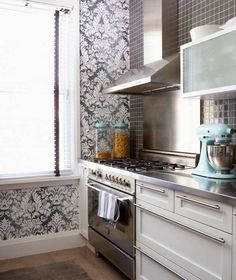 10 inspiring kitchens with blond wood wood cabinets for Kitchen cabinets lowes with damask decals wall art