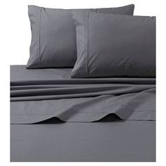 "These smooth, crisp, and durable deep pocket 100% cotton percale sheets feature double-band detailing for a luxurious experience. Sets include an oversized flat sheet and a fully elasticized deep pocket fitted sheet that fits mattress up to 22"" deep."