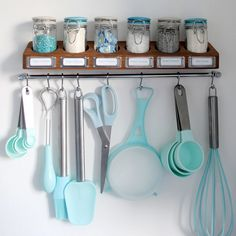 Create a hanging baking station  If you find yourself constantly reaching for the flour and sugar, make a one-stop shop for all your necessities. Bonus points if it's color-coordinated.