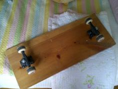cool custom skateboard... vintage.. my mom made this skateboard, the trucks are backwards, so sweet.