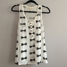 "SEQUIN Bow top White with black sequin bows adorning the front and back. Best worn with camisole underneath or tee.  Length 26""   Width 19""  sheer chiffon. Adorable reminds me of Kate spade Twentyone Tops Tank Tops"