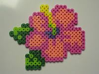 Flower coasters - Hibiskus, one of my fav flowers! this is amasing but the yellow thngie. I want it more brown ore black. it's usual a dark color! Perler Bead Designs, Perler Bead Templates, Hama Beads Design, Perler Bead Art, Melty Bead Patterns, Hama Beads Patterns, Beading Patterns, Flower Patterns, Flower Designs