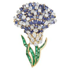 Gold, Platinum, Diamond and Gem-Set Flower Clip-Brooch  18 kt., the stylized flower set with 34 rectangular-cut diamonds and rectangular-cut sapphires, accented by 74 round and single-cut diamonds, diamonds altogether approximately 5.25 cts., the stem and leaves set with rectangular and triangular-cut emeralds, signed Tobias