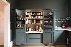 dream pantry cupboard with free standing microwaveby deVOL Kitchens Kitchen Larder Cupboard, Shaker Kitchen, Kitchen Storage, Kitchen Cabinets, Shaker Cabinets, Larder Cupboard Freestanding, Kitchen Larder Units, Kitchen Organisation, Pantry Storage