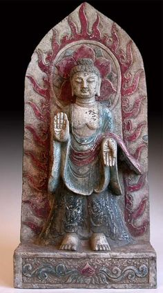 Shakyamuni displays the vitarka mudra on his right hand pointing towards the heavens, while his left displays the varada mudra downwards towards the earth. These mudras are gestures of protection and charity, respectively. (China, circa: Ming Dynasty, 1368-1644 A.D.)