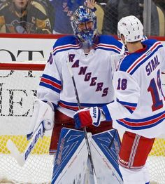 New York Rangers goalie Henrik Lundqvist (30) celebrates with teammate Marc Staal (18) after shutting out the Pittsburgh Penguins 3-0 in an NHL hockey game in Pittsburgh, Wednesday, Feb. 10, 2016. (AP Photo/Gene J. Puskar)