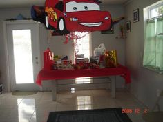 Cars Pinata is actually a rectangle box but the front is the design of Lighting McQueen drawn by my hubby and glued to the front.