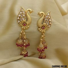 Peacock with Jhumki Style Earrings. Peacock with Jhumki Style Earrings. Rama Creations Manufacturer & Wholesalers of Artificial Fashion Jewellery in India. Gold Jhumka Earrings, Indian Jewelry Earrings, Jewelry Design Earrings, Gold Earrings Designs, Gold Jewellery Design, Designer Earrings, Bridal Jewelry, Jewellery Box, Antique Earrings