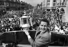 Dave MacKay of Tottenham Hotspur parades the FA Cup down the High Street in Tottenham. May 1967