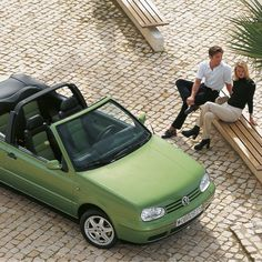 A vintage Volkswagen advert from the 90s featuring a green Golf III Cabriolet, which was introduced in 1993. Just as its predecessor, this convertible was built at the Karmann plant in Osnabrück.