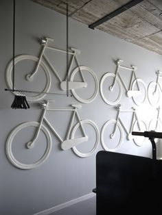 White Bike Room in the Volkshotel, Amsterdam. Everything in the room is bicycle. There is no cabinet, but bicycle bags on the wall. Lighting by bicycle lamps. You sleep in a carrier bicycle. Designed by: Thijs van Oostveen