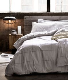 rustic wood bed & plain bedding (via H&M GB) - my ideal home...