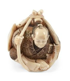 A Japanese ivory okimono of a man 20th century, in tinted clothing in a rope cage, signed. Height 8 cm